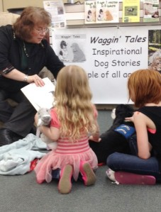 Gayle reading to children at The Knowledge Nook, toys & books in Casper