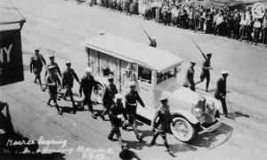 President Harding's hearse carries his body as onlookers watch.