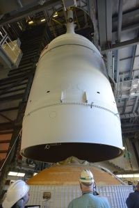 Enclosed by Ogive panels, the Orion is lifted up and mated to its launch vehicle, the Delta IV rocket.