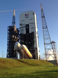 The Delta IV minus the Orion is lifted into position at the launch pad.