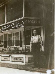 This fellow is Fred Snyder, Raymond's father. He and Raymond opened up a bakery on Main Street in downtown Rittman in 1915. He's standing in front of the bakery. By then Icie Bell saw Raymond in a better light and she and David Elmer gave their approval to Raymond's request to marry Ethel.