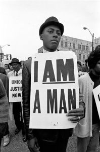 The Civil Rights Era and a black protester whose sign is both poignant and sad.