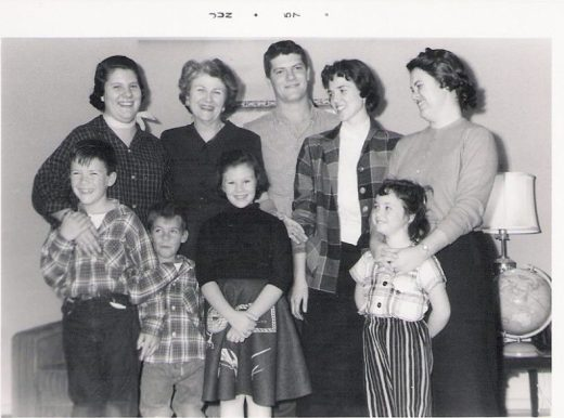 Back row: Cousin #2, our grandmother, Cousin #8, Cousin #6 (Cousin #7's wife), and Cousin #1 (the travel agent who wouldn't let me walk home). I'm the cute one in the striped slacks and plaid blouse (there was a reason for that) allowing Cousin #1 to put her hands on my shoulders. If I'd know how she would treat me later, I've stood elsewhere.