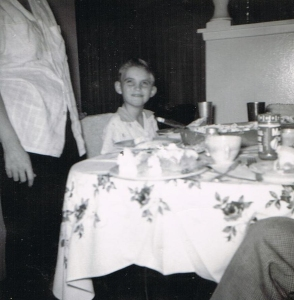 It's my birthday. This is shot before dad and mom bought a kitchen booth. Behind me is the curtain that covered the living room's sliding glass door.