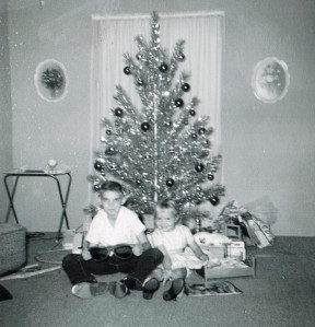 Well, aren't those a couple of cute kids circa the early 1960s. Yep, it's me and my sister Jody. Lots of folks had silver Christmas trees back then.