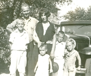 The car places the photo sometime in the 1920s or the early 1930s. It's Uncle Clarence, his wife Fern and their kids. Fern died young. Later, in the early 1950s, Clarence married Pauline after his brother Kenny passed away.