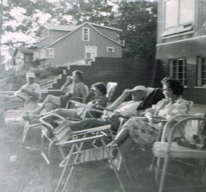 While the kids swam, the adults would sit in lawn chairs on the back porch at the Wolf Lake house and catch up on gossip.