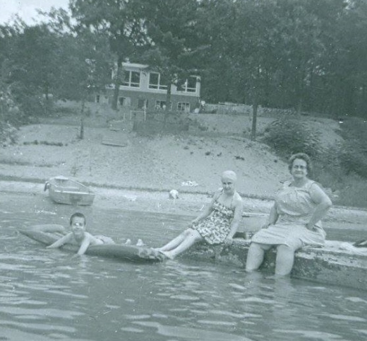 My cousin John Snyder floats on an inner tube while under the watchful eye of his mother Juanita and grandmother Ethel. The time period is circa late 1950s.
